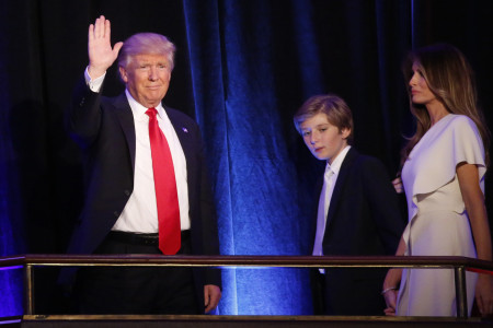 U.S. Republican presidential nominee Donald Trump arrives to speak at his election night rally with his son Barron and wife Melania in Manhattan, New York, U.S., November 9, 2016.       REUTERS/Carlo Allegri  - RTX2SPOP